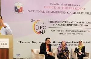 Sen. Paolo Benigno 'Bam' Aquino IV (left) speaks during the two-day conference on Islamic Finance organized by the National Commission on Muslim Filipinos (NCMF) in Makati City. Looking on are NCMF secretary/CEO Bai Yasmin Busran Lao (center), AMIN party-list rep. Sitti Djalia T. Hataman (right), and NCMF executive director Tahir Lidasan