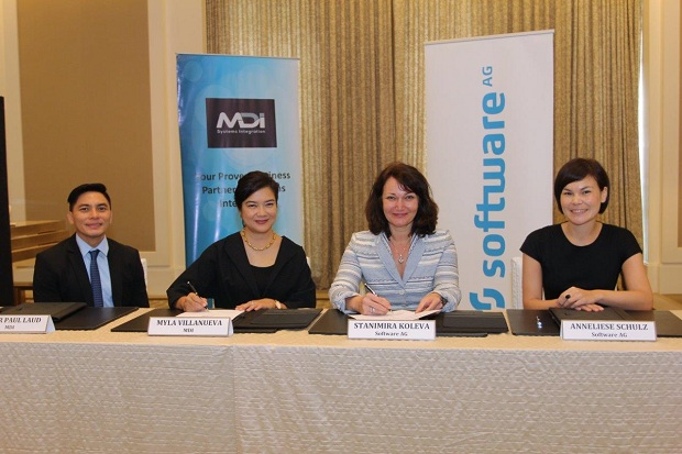 Photo shows Stanimira Koleva (second, right), chief operating officer of Software AG Asia Pacific and Japan, and Myla Villanueva, managing director of MDI, sign the partnership agreement on July 5 in Makati City. Others in the photograph are Anneliese Schulz, vice president for partner sales of Software AG (right), and Peter Paul Laud, sales director of MDI