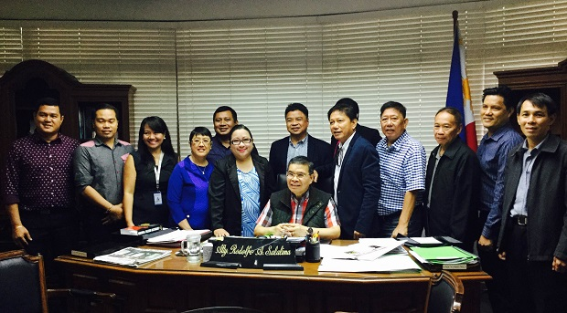 Officials of the NICP with DICT secretary Rudy Salalima (seated)