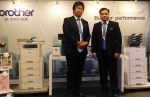 Photo shows Brother Philippines president Glenn Jocson (right) and general manager Masao Kasagi as they proudly stand behind their all-new mono laser printer series