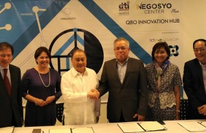 """DTI chief Ramon M. Lopez (3rd, right) and IdeaSpace chairman Manuel V. Pangilinan (3rd, left) shake hands after formalizing the partnership between DTI and IdeaSpace. Also signatories to MOU are Rene """"Butch"""" Meily (left) and DTI director Senen M. Perlada (right). The ladies in the group are Diane Eustaquio (2nd, left), executive director of IdeaSpace, and DTI undersecretary Nora K. Terrado"""