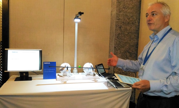 Perry Poehlmann, head of Nokia MBB Radio and MBB sales, demonstrates the use of cloud robots using 5G for smart home
