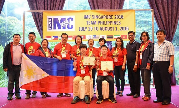 Gold medalists and grade level champions Julian Raymund Yu (seated left) of British School Manila and Jarrett Ian Lim of the Philippine Academy of Sakya (seated right) with Philippine team officials at the 12th International Mathematics Contest (IMC) in Singapore. (Photo credit: Anthony Hejie Suralta)
