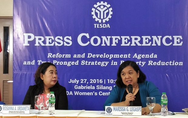 Marissa Legaspi, executive director of Tesda Planning Office (right) is shown during a press conference held at Tesda main office in Bicutan, Taguig City. At left is Tesda deputy director general Rosanna Urdaneta