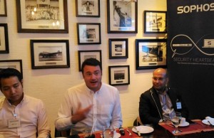 Photo shows Justin Peters, director for technology solutions at Sophos Asia Pacific (middle), explaining the Sophos Central during a media briefing on Aug. 3 at the Manila Peninsula in Makati City