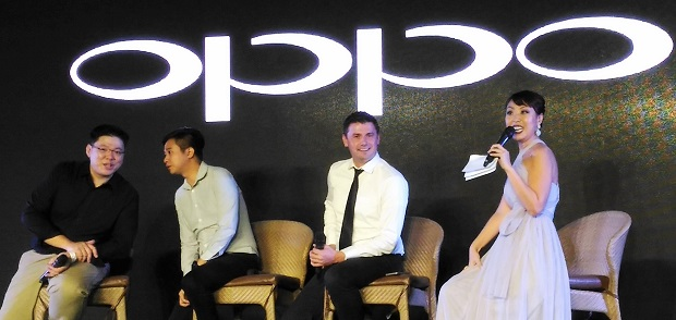 Oppo operations manager Garrick Hung (left) and Oppo brand marketing manager Stephen Cheng (2nd, left), and Home Credit Philippines head of sales Adam Bernasek (2nd, right) field questions from the media during Oppo F1s unveiling at Pico Sands Hotel, Batangas, on Thursday. At right is Korean TV host Sam Oh