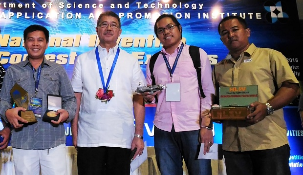 DOST secretary Fortunato T. dela Peña (second from left) with grand winner Melchor Henosa (left) of the 2016 National Invention Contest and Exhibits (Nice) at SMX Convention Center