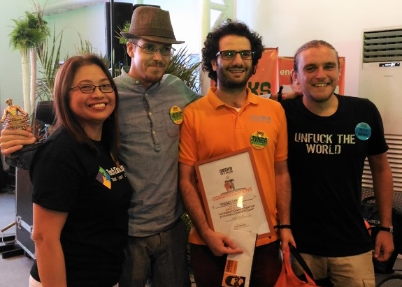 Photo shows GOAB organizer Tina Amper (left) with engageSPARK developers Murat Knecht, Avner Mizhrahi, and Nick Brown