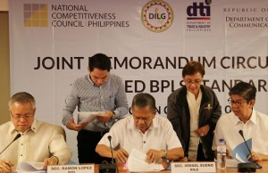 Photo shows (seated, from right) DICT undersecretary Jorge Sarmiento, DILG secretary Ismael Sueno, and DTI secretary Ramon Lopez signing the joint memorandum circular