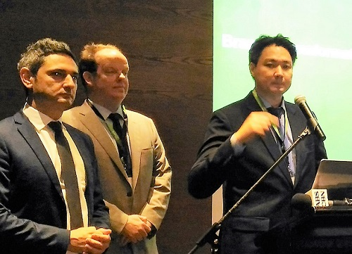 NCR Philippines country manager Carlo Cruz (at podium) with Yiannis Papadopoulos, NCR vice president for Southeast Asia Pacific (left), and Matthew Heap, director of marketing and solutions management for Asia Pacific at NCR Financial Services
