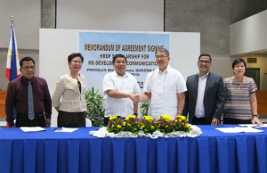 DOST secretary Fortunato dela Pena (third from right) seals the partnership with a handshake with University of the Philippines Los Baños (UPLB) chancellor Fernando C. Sanchez Jr.