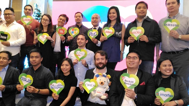 Lazada executives led by CEO Inanc Balci (center, light blue long sleeve shirt) and its partners pose during the launch of the month-long 2016 Christmas Online Revolution in Bonifacio Global City, Taguig City