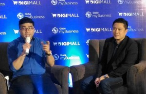 Globe myBusiness head of solutions marketing Ritchie Ramos (with microphone) discusses how SME owners can subscribe to Shopify-powered DigiMall Online Bazaar to promote their products online. At right is Derrick Heng, senior advisor for Globe's small and medium business group