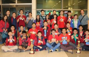 Students from the Philippines together with the coaches display the medals and trophies they won at the 7th International Young Mathematicians' Convention in India. Photo courtesy of MTG
