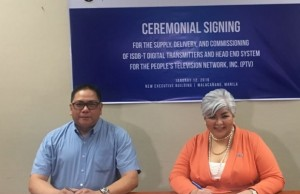 PTV-4 general manager Dino Apolonio (left) and NEC Philippines president Elizabeth Pangan