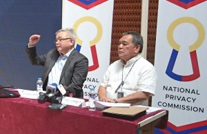 NPC chair Raymund Liboro (left) explaining the different levels of security necessary to protect personal data, with him is Comelec executive director Jose M. Tolentino Jr. at a press conference