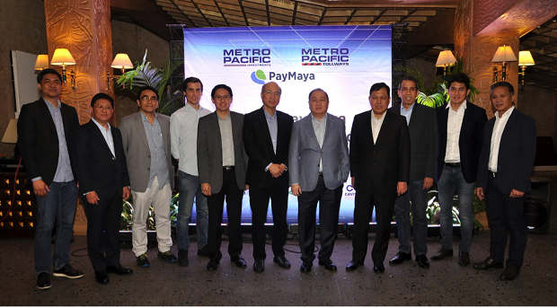 Officials of PayMaya and Metro Pacific Tollways Corporation, led by Manny V. Pangilinan (5th from right) are shown in photo