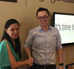 Uber Philippines GM Lawrence Cua (right) and Megaworld executive Jaevyn Valentino seal the partnership with a handshake