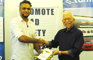 "Photo shows Carmudi Philippines managing director Abhi Mohan (left) and AAP president Augusto ""Gus"" Lagman"