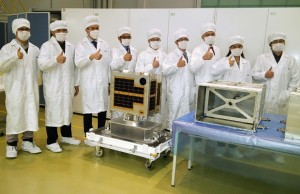 The 'Magnificent 9' Filipino engineers who helped design and construct the Diwata-1 micro-satellite in collaboration with two Japanese universities flash the thumps up sign