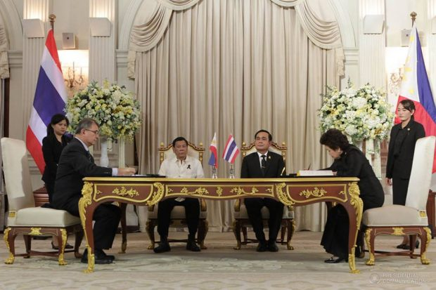 Pres. Rodrigo Duterte and Thai Prime Minister General Prayut Chan-o-cha witness the signing of the cooperation agreement in the field of science between DOST secretary Fortunato dela Pe?a and Science and Technology minister of Thailand Dr. Atchaka Sibunruang during a ceremony at the Government House in Bangkok on March 21