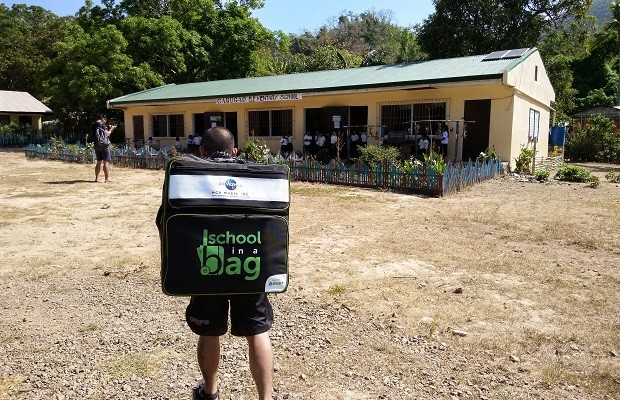 MCA Universal rep and Urbandub frontman Gabby Alipe carries the School-in-a-Bag which he turned over to Cabugao Elementary School in Coron Island, Palawan