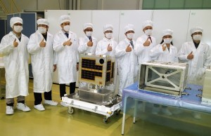Dubbed 'Magnificent 9' for being pioneers in the building of Diwata-1 micro-satellite, Filipino engineers flash the thumbs-up sign at the Japan Space Agency on January 13, 2016