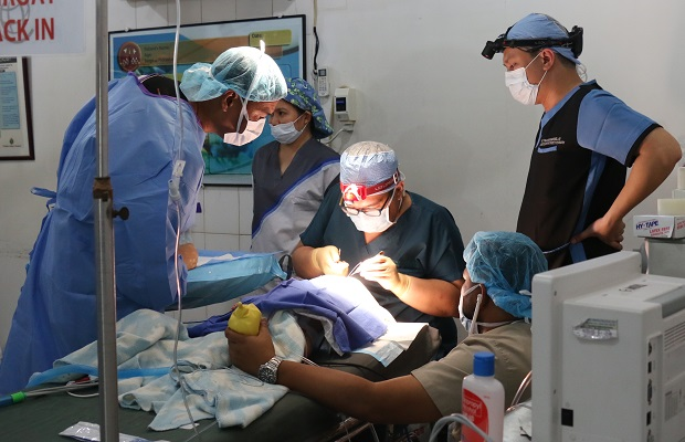 Doctors perform surgery on a cleft patient on the first day of the Operation Smile medical mission in Batangas City