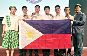 Philippine team members show the flag and their medals at the awarding ceremony of the 21st Junior Balkan Mathematical Olympiad (JBMO) in Bulgaria. They are (from left) coach Hazel Joy Shi, Immanuel Josiah Balete, Vincent Dela Cruz, Bryce Ainsley Sanchez, Aiman Andrei Kue, Eion Nikolai Chua and coach James Kelvin Martin