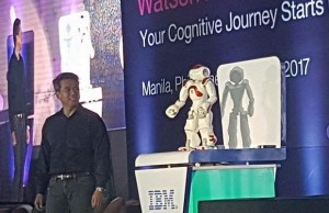IBM Philippines country general manager Luis Pineda interacts with Nao, an interactive robot based on IBM Watson during the  Watson Summit Philippines in Makati City. Photo credit: Mike dela Cruz, IBM