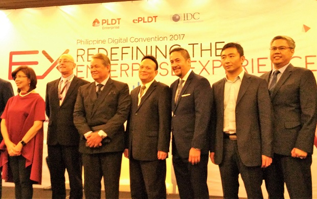 PLDT executives led by COO Eric Alberto (3rd from left) oblige for a photo-op during the media briefing at Marriot Hotel in Pasay City