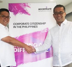 Photo shows Lito Tayag of Accenture PH (right) and Rey Laguda of PBSP