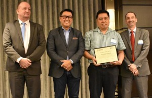 Dr. Romeric Pobre (3rd from left) of DLSU Manila receives the AGILA certificate from Art Tan (2nd from left), CEO and chairman of IMI, accompanied by Brian Levey (4th from left), director of Office of Education at USAID Philippines and Dr. David Hall, chief of party of USAID STRIDE (left)