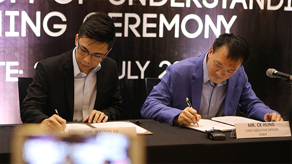 Paulo Sy, manager of TNC Gaming, and CK Hung, chief executive officer of Syber sign the memorandum of understanding