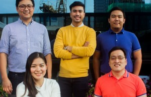 Taxumo co-founder and CEO EJ Arboleda (left, standing) with his co-founders