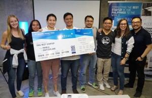 Members of the ServeHappy team display their prize for winning first place