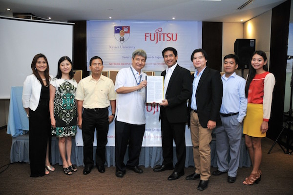 From left: Harriet B. Fernandez, director, Xavier University computing and information services office; Lennie K. Ong, Xavier University treasurer; Edison B. Sasoy, vice president for administration; Fr. Roberto C. Yap, SJ, university president;  Cricket Santiago, president and CEO of Fujitsu Philippines; Terry Ybanez, sales director, VisMin business unit; Sherwin Cortes, solutions architect; Joyce Punay, account manager, VisMin sales business unit
