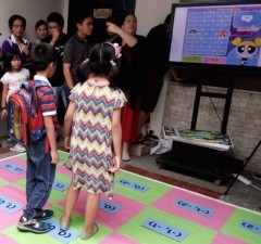 Kids play in a game that allows them to learn about the Cartesian plane