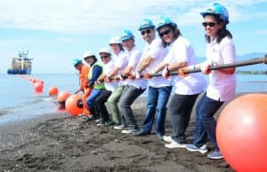Globe VP for sourcing and international facilities investments Arlene Jallorina (right) and Globe VP for enterprise product management Cindy Salaya (2nd from right) lead the pulling of the SEA-US cable in Brgy. Talomo, Davao City. Photo credit: Globe Telecom