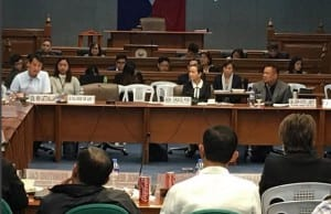 Senators Sherwin Gatchalian, Grace Poe, and JV Ejercito confronting LTFRB officials (foreground) during a recent Senate hearing