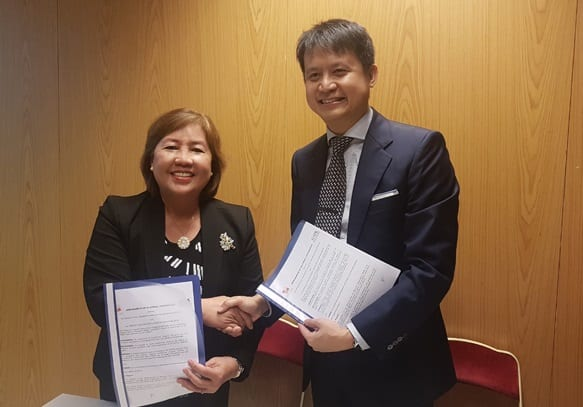 IPOPHL director-general Josephine R. Santiago seals the Memorandum of Bilateral Cooperation with a handshake with Intellectual Property Office of Singapore (IPOS) chief executive Daren Tang for the cooperation in the development and promotion of the intellectual property system in the Philippines and Singapore