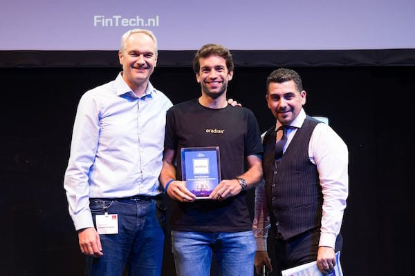 Oradian's cloud-based banking software Instafin wins the award for Europe's 'Most Innovative Banking Software' after co-founder Julian Oehrlein's (C) performance in the pitch competition against Europe's most prospective technology companies.