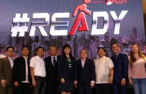 PLDT chairman and CEO Manny V. Pangilinan (4th from right) shares a photo-op with other executives and official of LGUs during the launch of #Ready initiative for public safety