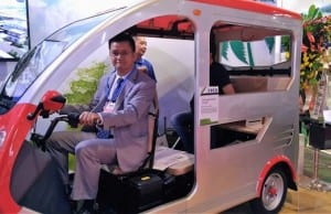 Ropali-Teco Corporation President Eric Lin poses on an eTrike assembled at Subic Bay Freeport Zone. (EKU)