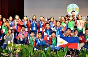 Filipino students display their medals at the awarding ceremony of the 14th International Mathematics and Science Olympiad for Primary School in Singapore (Photo by MTG)