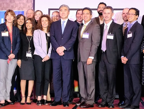 United States Ambassador Sung Kim (4th from left) and IBM president and country manager Luis Pineda (3rd from right), are joined by IBM officials and IBMers and Peace Corps volunteers on Oct. 26 in Mandaluyong City. (EKU)