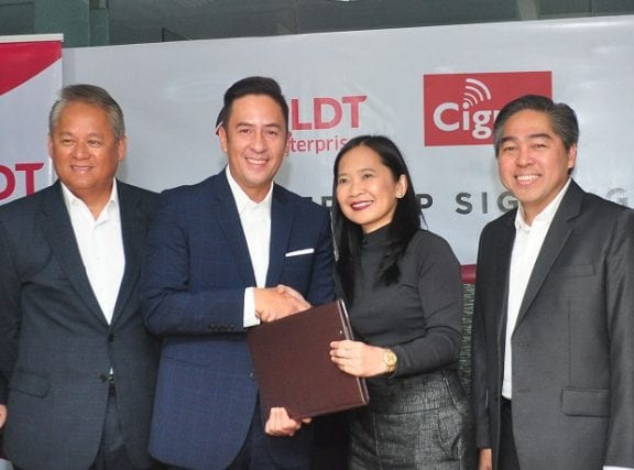 From left: PLDT chief revenue officer Eric Alberto, senior vice and head of PLDT and Smart Enterprise Groups Jovy Hernandez, Cignal TV president and CEO Jane Basas, and Cignal TV first vice president for sales Robert Galang